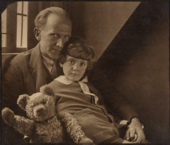 Milne with his son Christopher Robin and Pooh Bear, at Cotchford Farm, their home in Sussex. Photo by Howard Coster, 1926. (via Wikipedia)